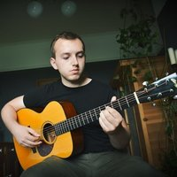 Conservatoire trained fingerstyle guitarist, offering guitar lessons and guidance for all levels.