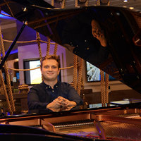 Freelance Musical Director offering piano, singing, theory or songwriting lessons. Beginners - Advanced