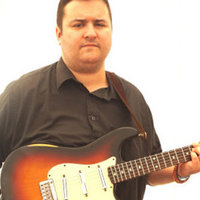 Professional guitar player offering lessons including, sight reading, singing, and music theory