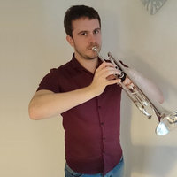Tooting trumpet player teaches brilliant brass and wonderful woodwind to stupendous students